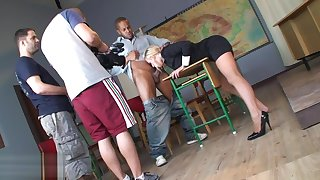 Bimbo in despondent uniform and stockings Carla Cox giving a shoejob footjob