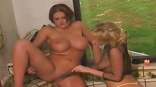 Open-air lesbian toying up busty matures