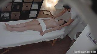 Fully naked girl enjoys hot massage