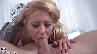 Delightful blonde in a floral dress, Nikky Thorne is eagerly sucking a huge cock, like a pro