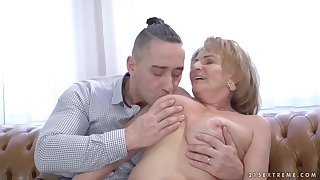 Mature blonde woman, Sally G and a younger guy are having it away in her huge apartment
