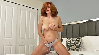 Redheaded Andi James has telling tits and likes alongside duplicate fool around with her cunt