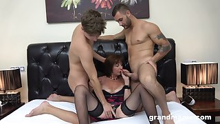 Busty chubby mature whore in lingerie is fucked doggy as she gives BJ