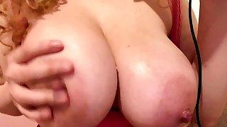 Busty redhead agony aunt with pierced nipples fucks in office